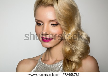 Beauty Blonde Woman Portrait. Beautiful model girl with curly blond hair. Hairstyle. Sexy Model. Perfect Skin and Make up. - stock photo