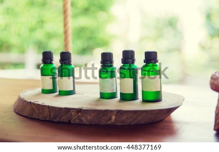 beauty, body care, luxury and health spa concept - close up of aromatic oil bottles set at hotel room - stock photo