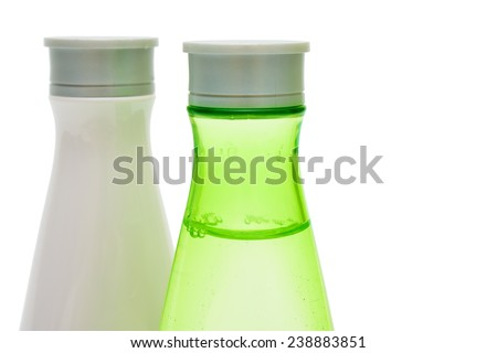 Beauty bottles (green and white) closeup isolated - stock photo