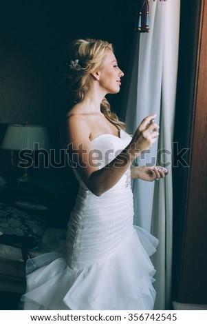 Beauty bride applying perfume  - stock photo