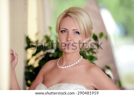 Beauty bride in bridal gown on the nature. Beautiful model girl in a white wedding dress. Female portrait in the park. Woman with hairstyle. Cute lady outdoors - stock photo