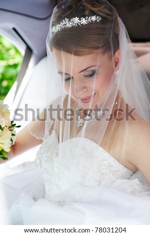 Beauty bride in wedding limousine - stock photo