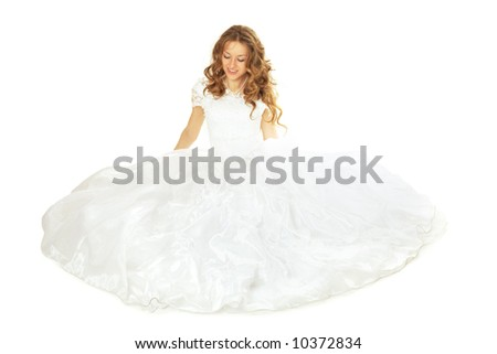 beauty bride in white dress seating on floor isolated - stock photo