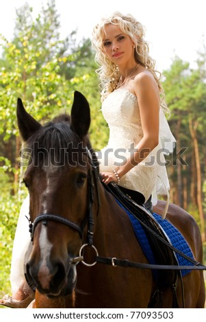 Beauty bride in white dress with horse