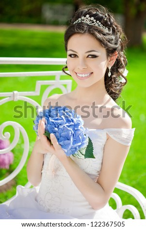 Beauty bride on a field in the sunshine - stock photo