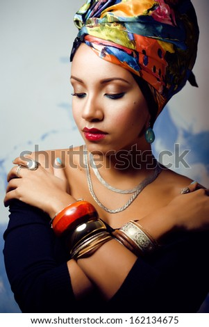 beauty bright african woman with creative make up, shawl on head like cubian woman - stock photo