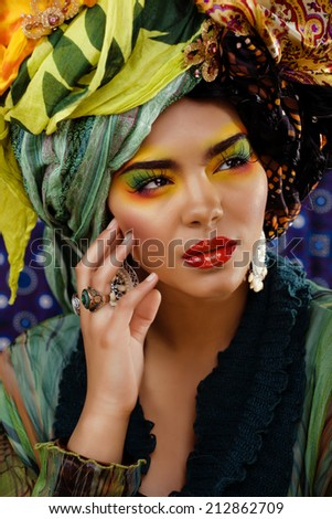 beauty bright black skined woman with creative make up, many shawls on head like cubian woman - stock photo