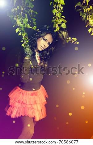 Beauty brunette girl posing over dreamy background - stock photo