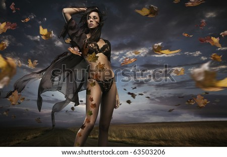 Beauty brunette in the windy weather - stock photo