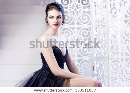 Beauty Brunette model woman holiday make up. Elegant girl in black dress - stock photo
