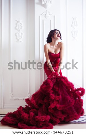 Beauty Brunette model woman in  evening red dress. Beautiful fashion luxury makeup and hairstyle,   full length
