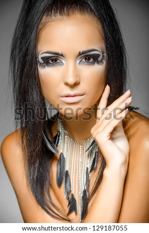 Beauty brunette portrait. Beautiful woman with black hair. Professional makeup - stock photo