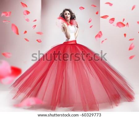 Beauty brunette wearing fashionable dress - stock photo