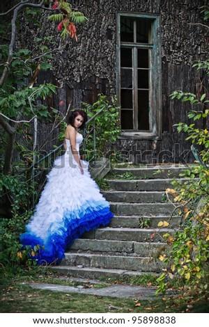 Beauty brunette wearing wedding dress - stock photo