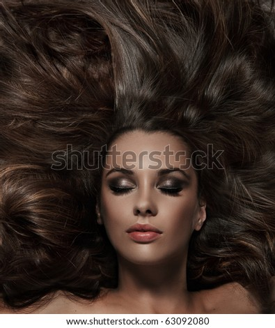 Beauty brunette with long hair - stock photo