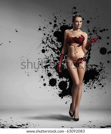 Beauty brunette with paint splash - stock photo