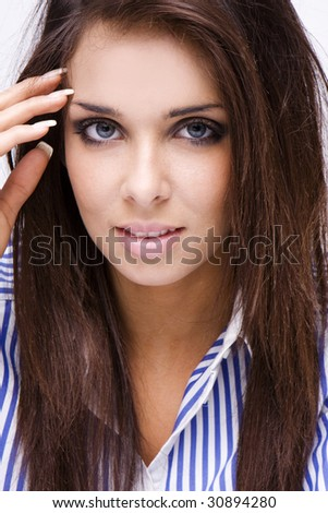 beauty brunette woman face with blue eyes and blue shirt, - stock photo
