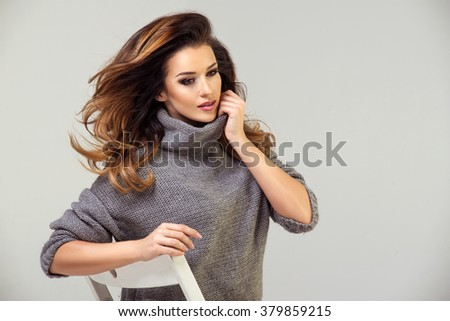 Beauty brunette woman on chair  - stock photo