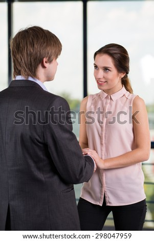 Beauty businesswoman flirting with coworker during break - stock photo