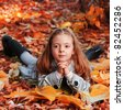 beauty child in autumn park - stock photo