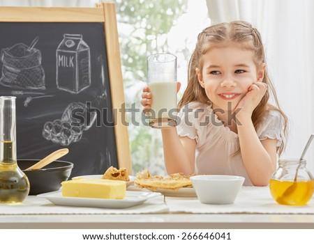 beauty child prepare pancakes - stock photo