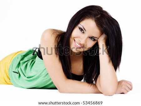 Beauty close-up face of young woman lying down - stock photo