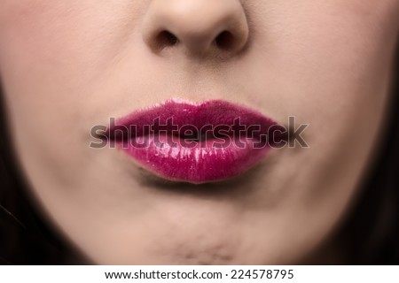 beauty close up of a young woman mouth shot in the studio