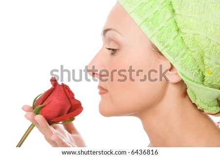 beauty close-up  spa woman face in green towel with rose over white background - stock photo