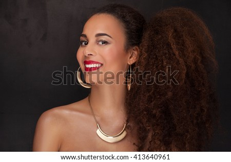 Beauty closeup portrait of young  african american girl . Ideal skin. Woman in fashionable elegant jewelry. - stock photo