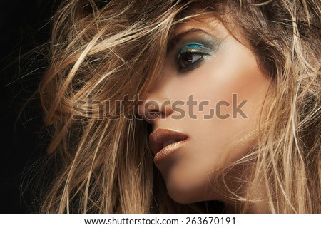 Beauty closeup portrait of young sexy woman against dark background, beauty and makeup concept. - stock photo