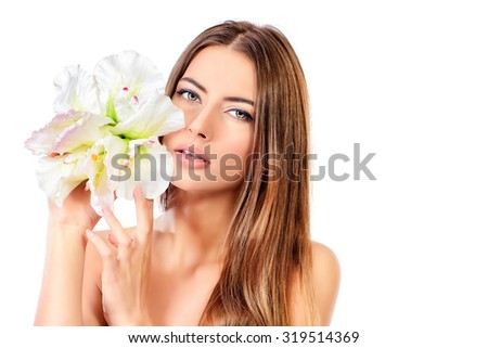 Beauty concept. Tender young woman with clean fresh skin posing with white flower. Skincare, bodycare. Spa. Isolated over white. Copy space. - stock photo