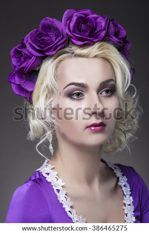 Beauty Concepts. Closeup Portrait of Caucasian Blond Female Model In Purple Dress with Violet Flowery Crown.Vertical Image - stock photo