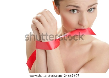 Beauty cosmetic portrait of funny tied hands woman with red tape - stock photo