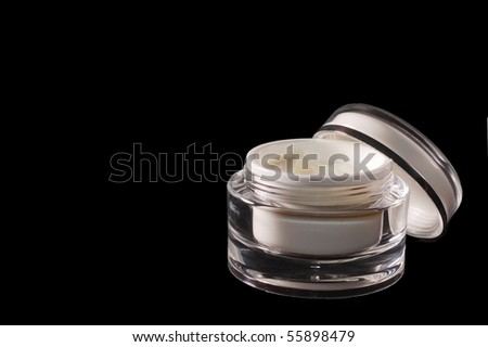 Beauty Cream in a Single Jar on Black with room for Text - stock photo