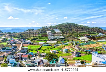 Beauty Da lat highland homes interspersed with vegetable gardens, planting flowers greenhouse, so far as hill with beautiful pine forests and idyllic in the highlands - stock photo