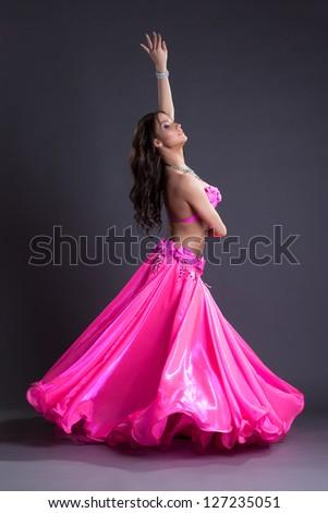 Beauty dancer performing oriental dance - stock photo