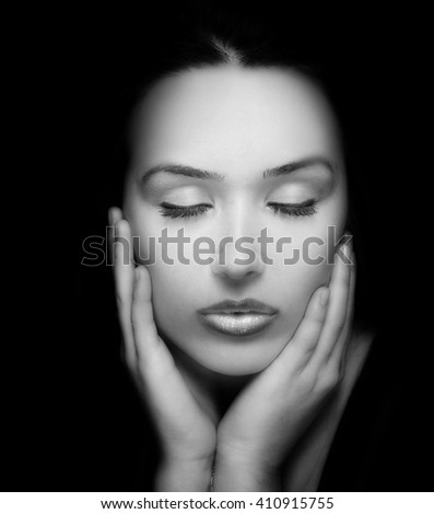 Beauty Dark Portrait. Face and Hands of Beautiful Young Woman