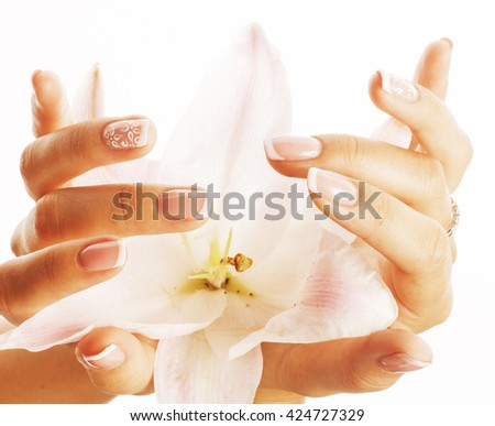 beauty delicate hands with manicure holding flower lily close up isolated on white - stock photo