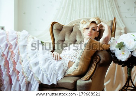 beauty emotional blond bride in luxury interior - stock photo
