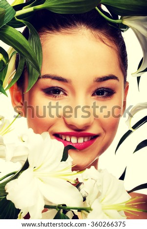 Beauty face of a woman with flowers. - stock photo