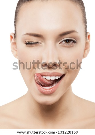 Beauty face of funny girl with clean fresh skin - isolated - stock photo