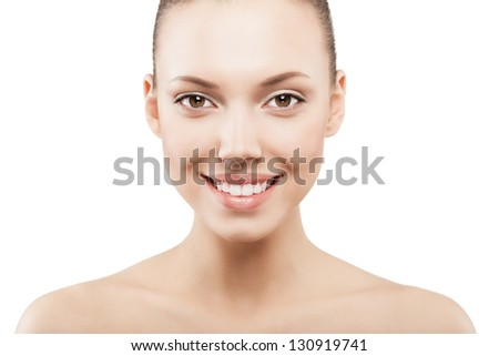 Beauty face of happy girl with clean fresh skin - isolated - stock photo