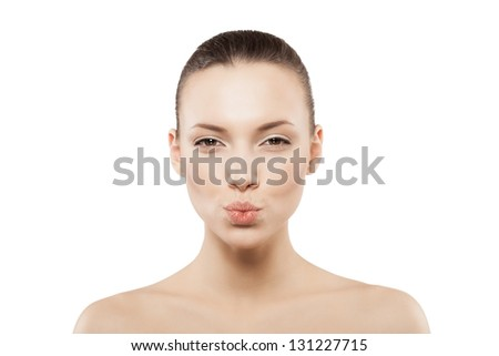 Beauty face of kissing woman with clean fresh skin - isolated - stock photo