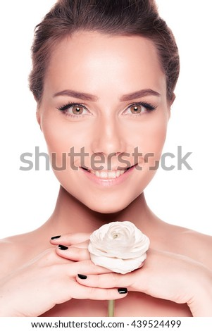 Beauty face of the young beautiful woman with flower. Female touching skin. isolate shot