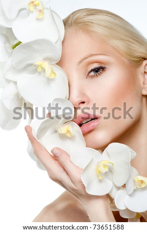 Beauty face of the young beautiful woman with flower. Girl on white background - stock photo