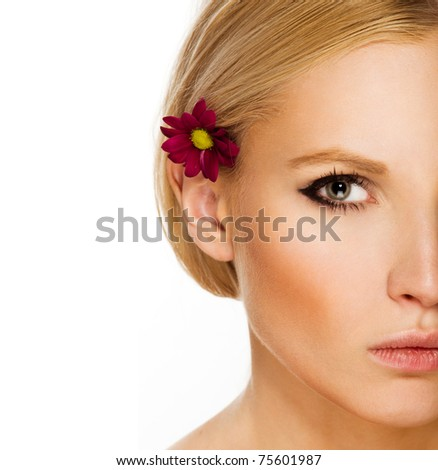 Beauty face of the young beautiful woman with flower. Girl on white background