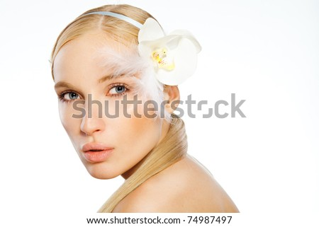 Beauty face of the young beautiful woman with flower on white background