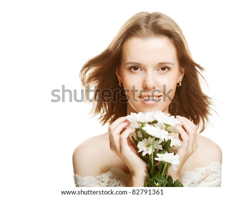 Beauty face of the young beautiful woman with flowers. Girl on white background