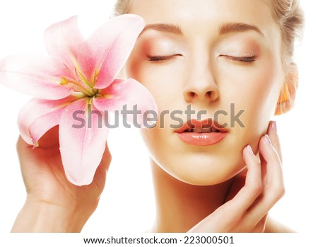 Beauty face of the young woman with pink lily isolated on white - stock photo