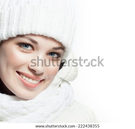 beauty face portrait of attractive young caucasian woman in warm clothing  studio shot isolated on white toothy smiling winter